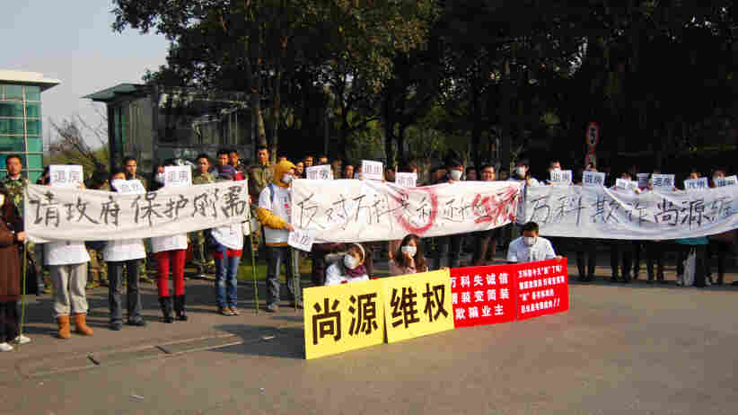 About 100 recent homebuyers protested plunging real estate values at China Vanke, a Chinese real estate company, on Sunday in Shanghai. The protesters said they wore surgical masks to hide their identities.