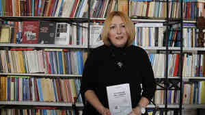 Historian and cookbook author Eleni Nikolaidou with her book Starvation Recipes. Recession-hit Greeks are fascinated with the book's World War II-era survival tips and recipes.