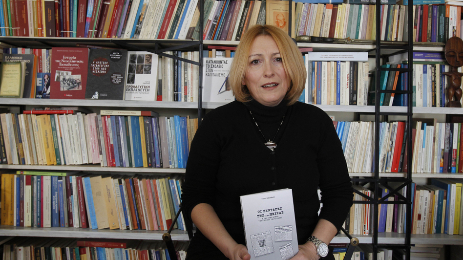Historian and cookbook author Eleni Nikolaidou with her book Starvation Recipes. Recession-hit Greeks are fascinated with the book's World War II-era survival tips and recipes. (ASSOCIATED PRESS)