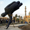 U.S. troops topple a statue of Saddam Hussein on April 9, 2003, the 21st day of Operation Iraqi Freedom, in central Baghdad.