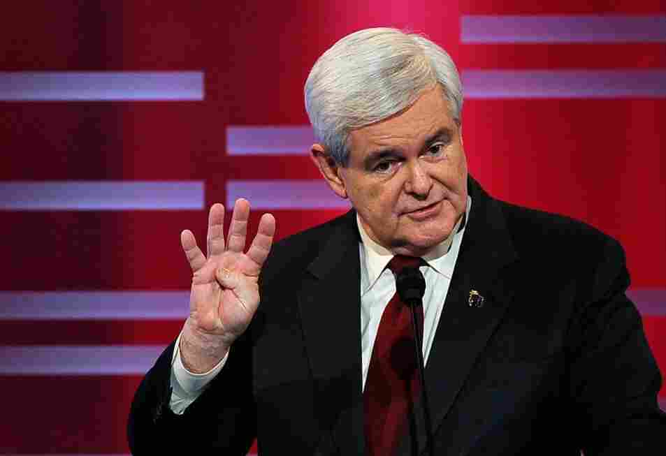 Former Speaker of the House Newt Gingrich, seen here during Saturday's ABC debate, is currently leading in GOP polls. His tax plan would introduce a 15 percent flat income tax.