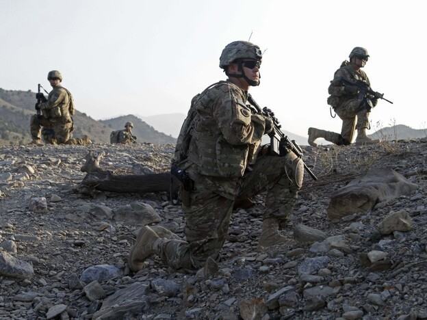 Staff Sgt. Joshua White (center), Command Sgt. Maj. John Troxell (left) and Brigade Sgt. Maj. Mike Boom (right) observe a joint patrol of U.S. Army and Afghan National Army soldiers and Afghan police in Paktika province, Afghanistan, on Oct. 3. The mountainous border between Afghanistan and Pakistan has become a new front line in the Afghan war.