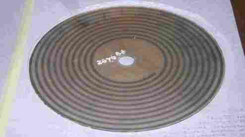A large glass photodisc from the Smithsonian collection of early sound recordings.