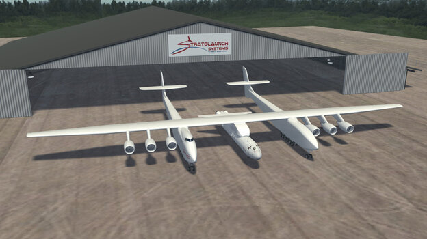 A computer-generated image provided by Stratolaunch shows the planned carrier aircraft, with a rocket attached on its centerline and six jet engines suspended beneath its wings.