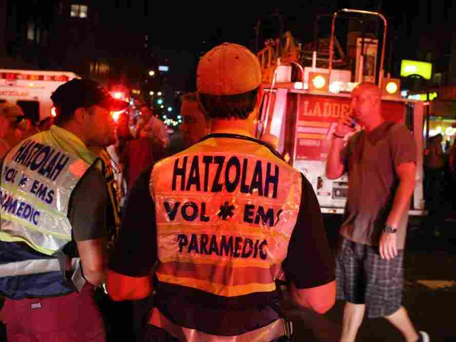 A Hatzolah ambulance crew at the scene of a fire at Congregation Kehilath Jeshurun synagogue in New York City last summer. Some Hasidic women want to form their own EMT unit within the Orthodox Jewish ambulance service to help women keep their modesty during emergency baby deliveries.