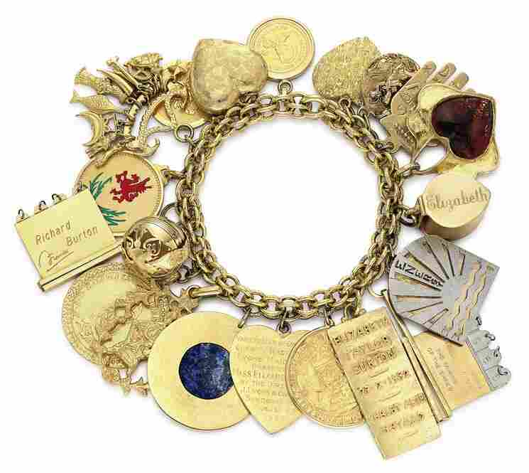 Burton also gave Taylor this charm bracelet, estimated to be worth between $25,000 and 35,000. Among the 20 charms is a locket that opens to reveal four medallions, each engraved with the names and birthdates of Taylor's four children.