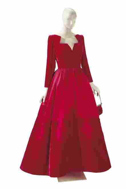 A velvet and satin Valentino ball gown with a matching satin evening bag.