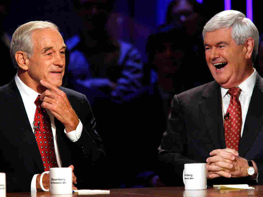 Republican presidential candidates Ron Paul and Newt Gingrich laugh at a presidential debate at Dartmouth College in Hanover, N.H., in October.