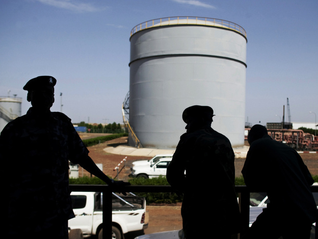 South Sudanese security forces stand outside the control room of the Petrodar oil facility in Paloich, South Sudan. Sudan was once sub-Saharan Africa's third-largest oil producer, but much of that oil came from what is now South Sudan.