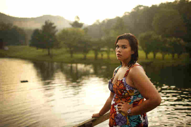 These photos document five students when they first arrived at Wellspring in August — and again two months later. Here, Bethany Gomez poses by the lake on campus.
