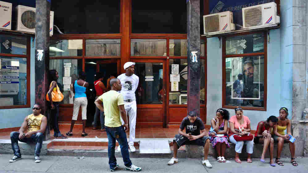 Cubans wait to go online at an Internet cafe in Havana earlier this year. The Cuban government announced months ago that a new fiber-optic cable to Venezuela would improve Internet access and speeds, but that still hasn't happened.