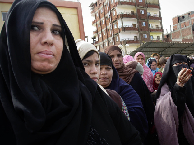 Women stand in line to cast their votes in Suez, Egypt, on Wednesday. For months after the revolution, the port city had no government or services. Some voters are turning to the Salafists or the Muslim Brotherhood to bring change.