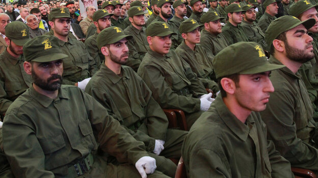 Hezbollah members listen to a speech by the group's leader, Â Hassan Nasrallah, via video-link in the southern suburbs of Beirut on Nov. 11, 2011.