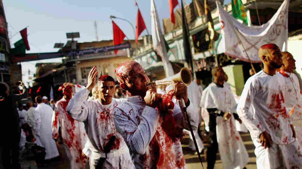 Shiite worshipers march after cutting their scalps in a ritual display of mourning during an Ashura ceremony outside Kadhimiya shrine in Baghdad on Dec. 6. Shiite festivals such as this were prohibited under dictator Saddam Hussein, a Sunni. Shiite Iran is seeking greater influence in Iraq, and Iraq's Sunni neighbors are doing the same.