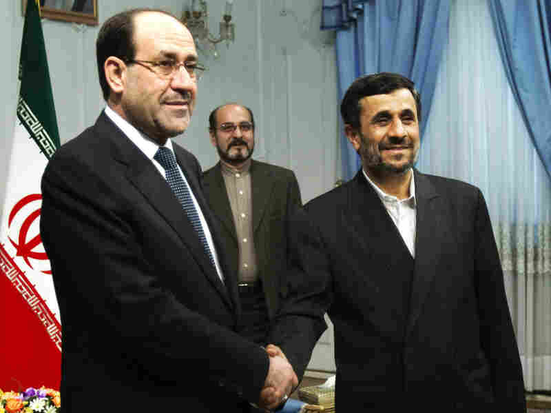 Iraqi Prime Minister Nouri al-Maliki (left) shakes hands with Iran's President Mahmoud Ahmadinejad during an official meeting in Tehran last year.