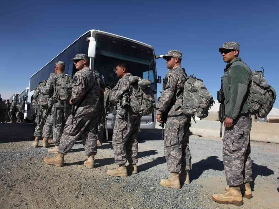 U.S. Army soldiers from the 1st Cavalry Division load onto a bus after exiting from Iraq on Dec. 14, 2011 at Camp Virginia, near Kuwait City, Kuwait.