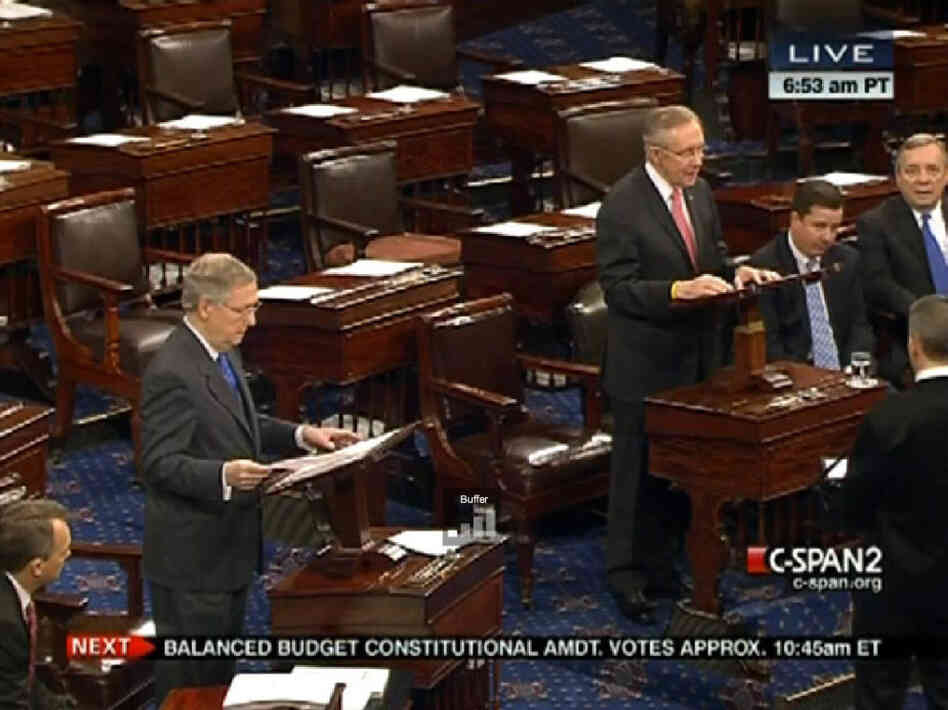 Sen. Mitch McConnell, Republican (left) and Sen. Harry Reid, Democrat, face off.