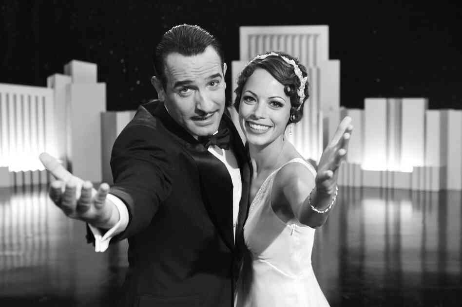Jean Dujardin (left) and Berenice Bejo in The Artist. Critics in New York selected The Artist as the best picture.