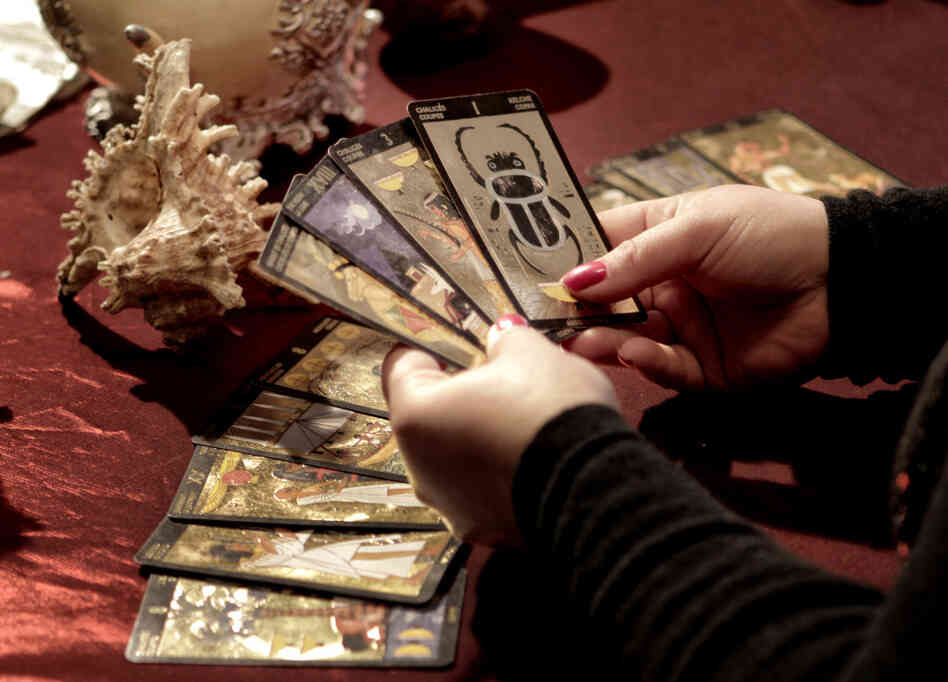 Romanian witch Mihaela Minca holds cards during an interview with The Associated Press in Mogosoaia, Romania in January.