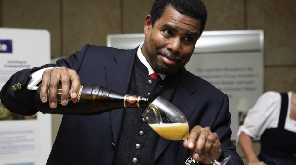 Garrett Oliver pours beer at one of the hundreds of tastings he has led during his career. (Courtesy of Brooklyn Brewery)
