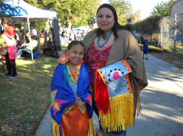 Serenity Wyatt, 8, and her mother, April Duenas, attend the 28th annual powwow held by California State University, Northridge.