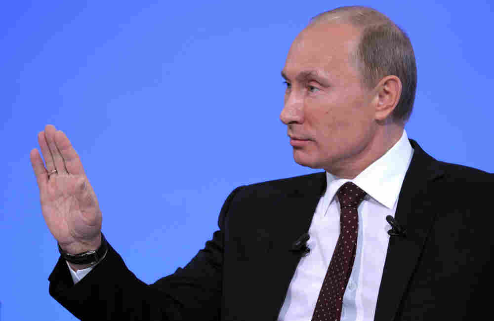 Russia's Prime Minister Vladimir Putin gestures during his annual phone-in session with Russians in Moscow.
