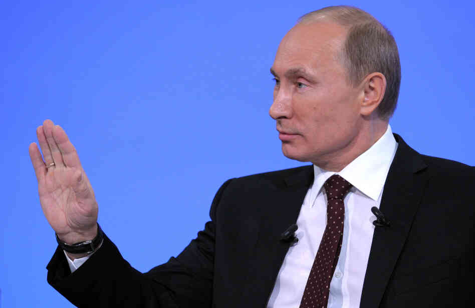 Russia's Prime Minister Vladimir Putin gestures during his annual phone-in sessio