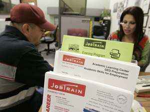 A counselor (right) talks with a man about training programs at a nonprofit training and job placement center in Menlo Park, Calif. Seventy percent of the long-term unemployed and underemployed would like the government to offer more job training services, an NPR/Kaiser Family Foundation poll found.
