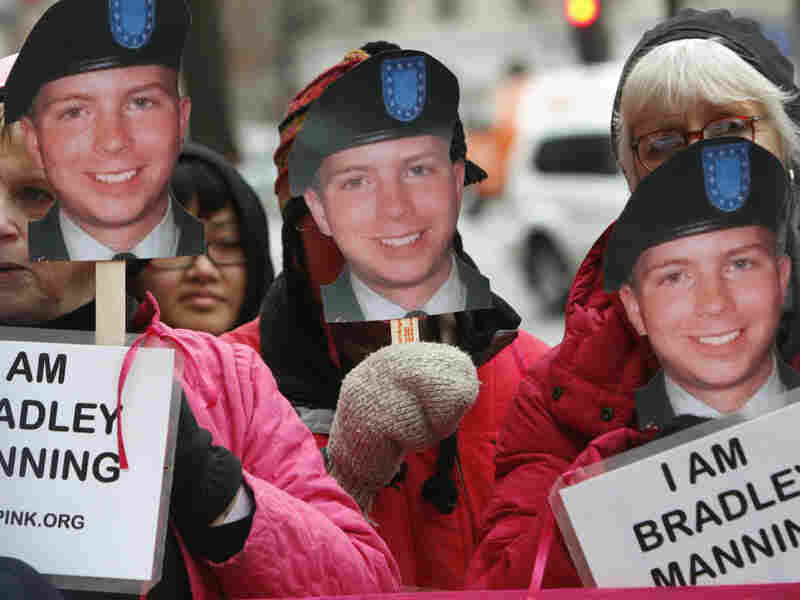CodePink activists hold signs last January in support of U.S. Army Pfc. Bradley Manning, the alleged leaker of documents to WikiLeaks. Manning will appear in court for the first time Friday.