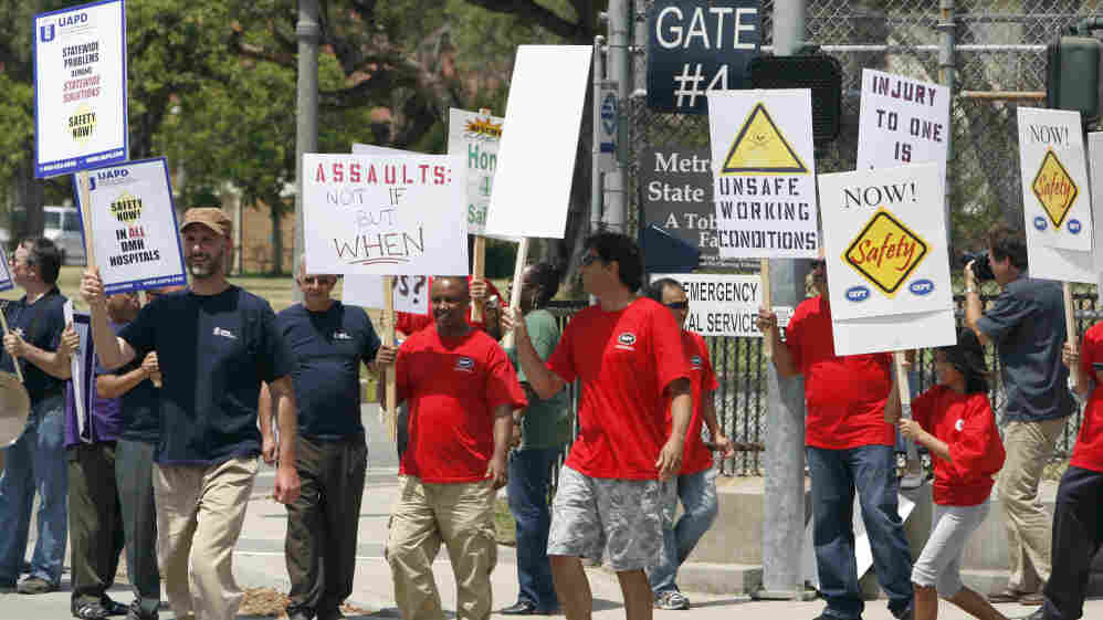 Metropolitan State Hospital employees and supporters gathered outside the hospital in Norwalk, Calif., this summer to protest repeated assaults at the hands of mental patients, and what they called dangerous working conditions.