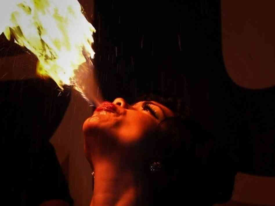 A woman breathing fire