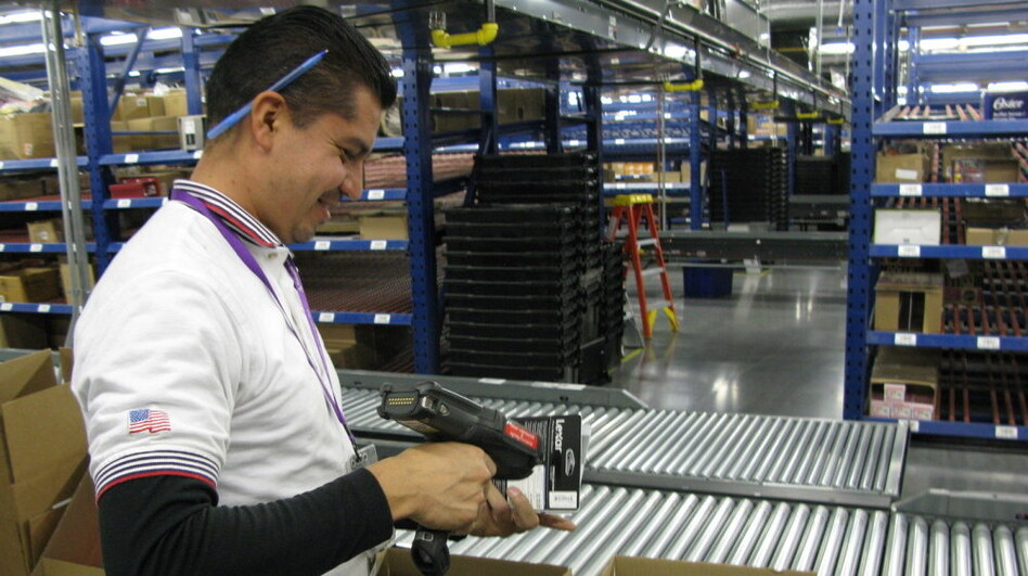 Javier Polendo, an employee at a largely automated Target.com fulfillment center in Tucson, Ariz., scans items to be shipped to online customers.