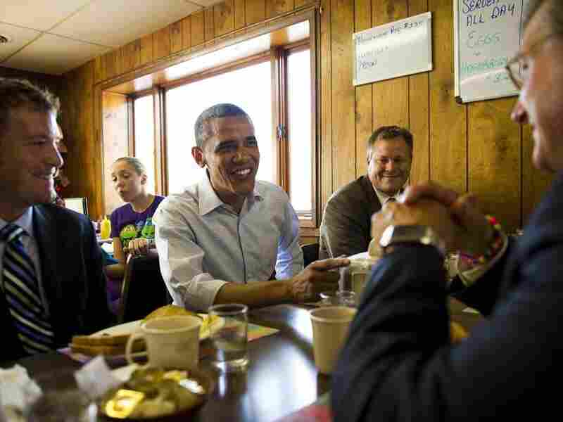 President Obama speaks with small-business owners at Rausch's Cafe in Guttenberg, Iowa, during a three-day Midwest bus tour in August.