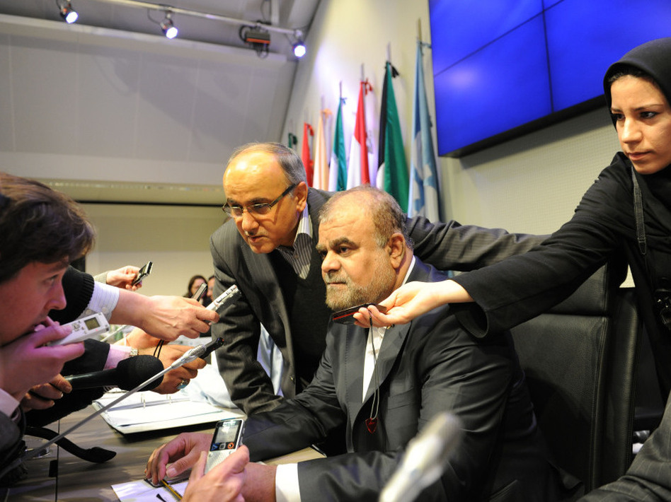 Reporters interview Iranian Minister of Petroleum Rostam Ghasemi before the start of the 160th meeting of the OPEC Conference in Vienna, Dec. 14. The global market for oil complicates the issue of U.S. sanctions against Iran.
