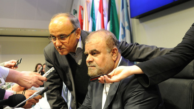 Reporters interview Iranian Minister of Petroleum Rostam Ghasemi before the start of the 160th meeting of the OPEC Conference in Vienna, Dec. 14. The global market for oil complicates the issue of U.S. sanctions against Iran. (Xinhua /Landov)