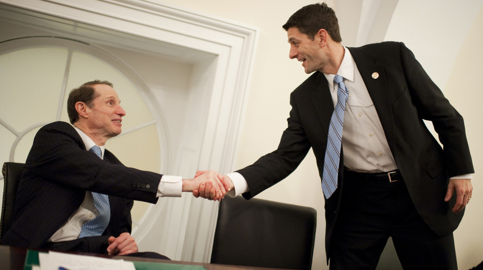 Oregon Sen. Ron Wyden, a Democrat, (left) and House Budget Committee Chairman Paul Ryan, a Wisconsin Republican, present their plan for changing Medicare at the U.S. Capitol Thursday. (Roll Call/Getty Images)