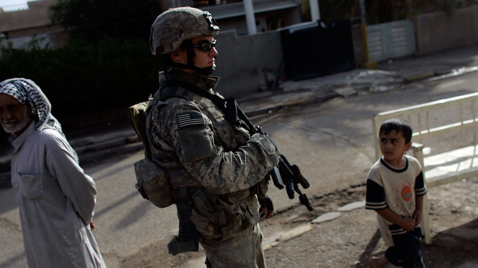 U.S. Army Specialist Zachery King patrols Baghdad in 2007, the year the U.S. military added some 30,000 troops to the battle in Iraq.