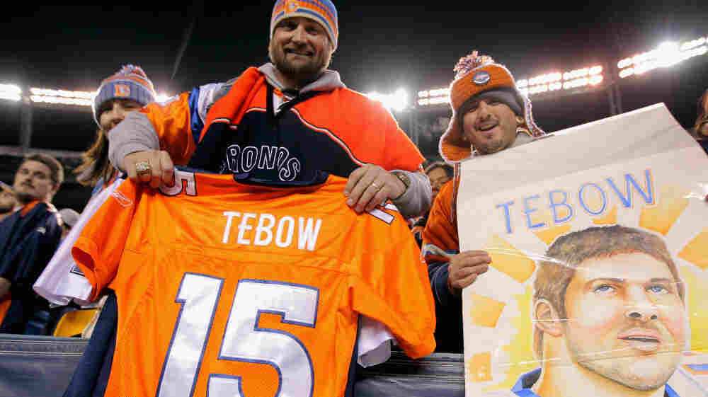 Fans show their support of quarterback Tim Tebow.