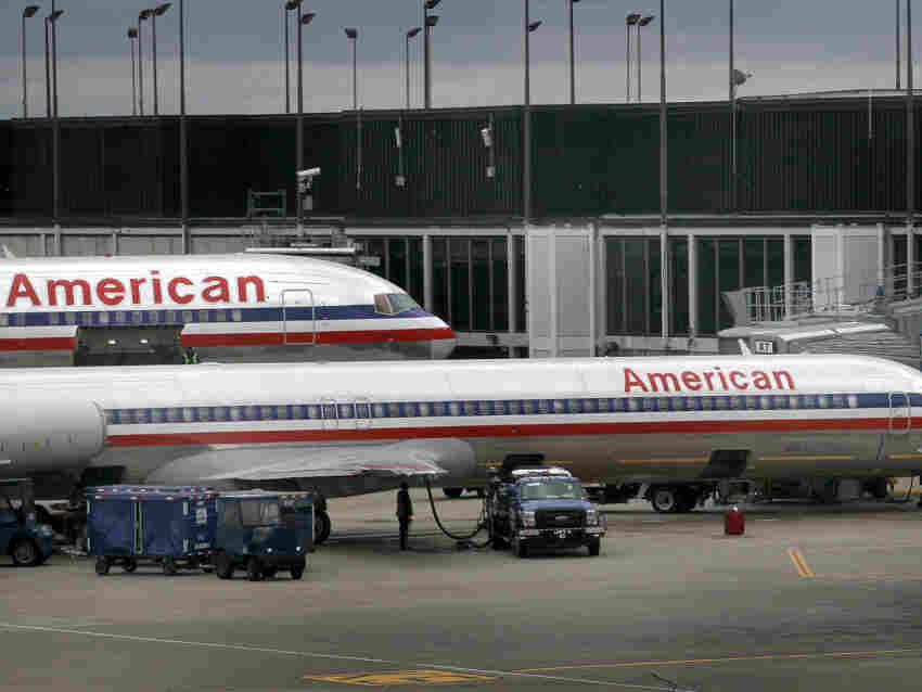 American Airlines jets sit at gates at O'Hare Airport.