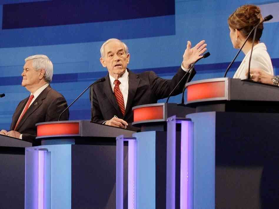 Republican presidential candidates, former House Speaker Newt Gingrich, Rep. Ron Paul, R-Texas, and Rep. Michele Bachmann, R-Minn., participate in a presidential debate in Sioux City, Iowa.
