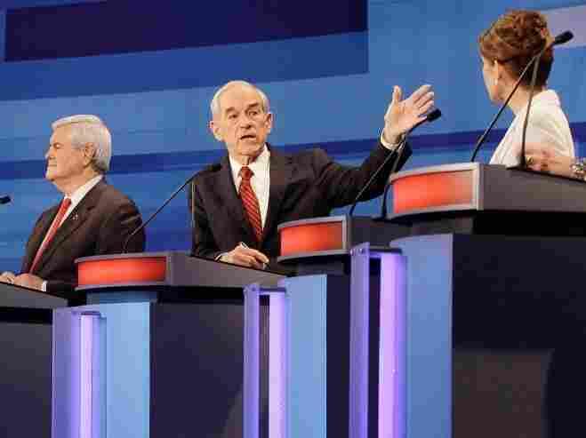 Republican presidential candidates, former House Speaker Newt Gingrich, Rep. Ron Paul, R-Texas, and Rep. Michele Bachmann, R-Minn., participate in a presidential debate in Sioux City, Iowa.