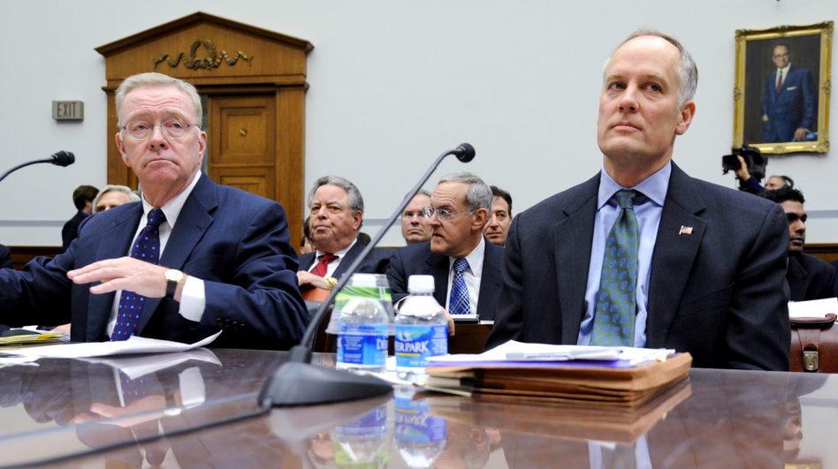 On Dec. 9, 2008, former Freddie Mac CEO Richard Syron (left) and former Fannie Mae CEO Daniel Mudd wait to testify on Capitol Hill in Washington. The Securities and Exchange Commission has brought civil fraud charges against six former top executives at Fannie Mae and Freddie Mac, including Syron and Mudd.