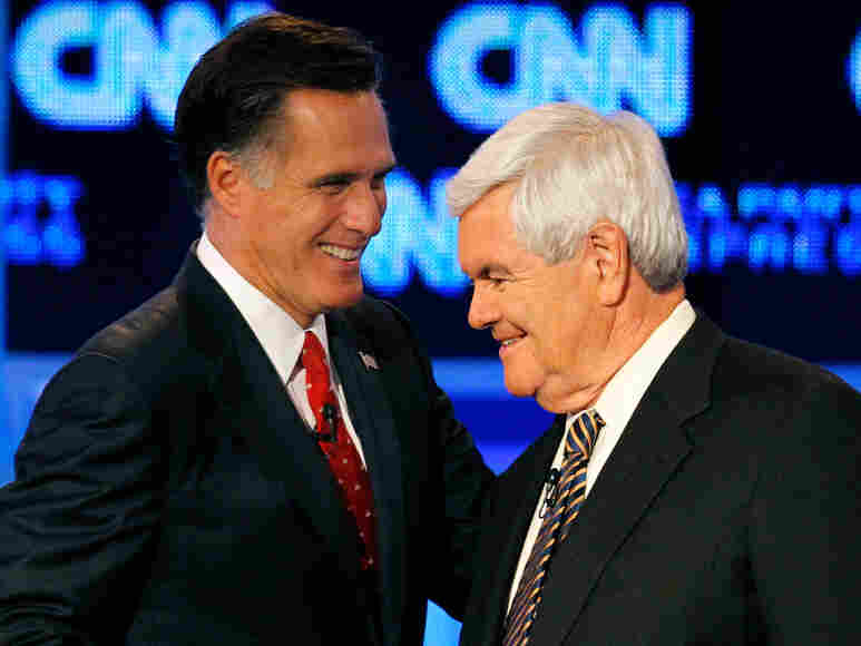 Republican presidential candidates former Massachusetts Gov. Mitt Romney, left, and former House speaker Newt Gingrich shake hands after a Republican presidential debate earlier this month.