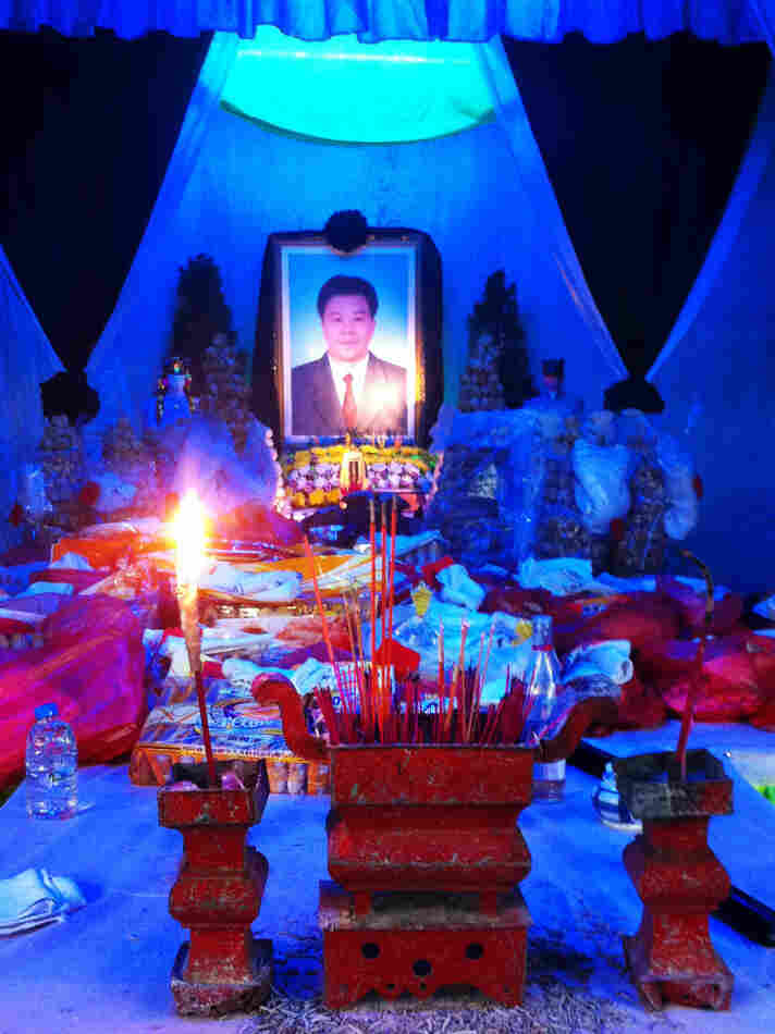 An altar in honor of Xue. Residents in his home village of Wukan believe he was detained and beaten by police for the role he played as a negotiator in a land dispute with the local government.