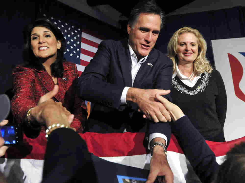 South Carolina Gov. Nikki Haley (left), former Massachusetts Gov. Mitt Romney and his wife, Ann Romney, shake hands with supporters during a rally in South Carolina on Friday. Haley endorsed Romney for the presidency.