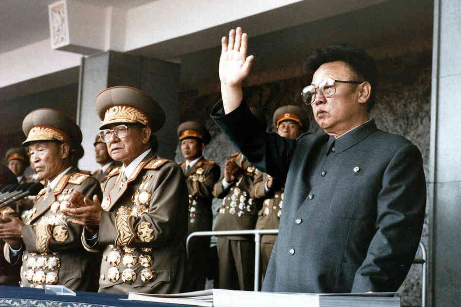 1995: Kim Jong Il (right) waves at a military parade to celebrate the 50th anniversary of the founding of the Workers' Party of Korea.