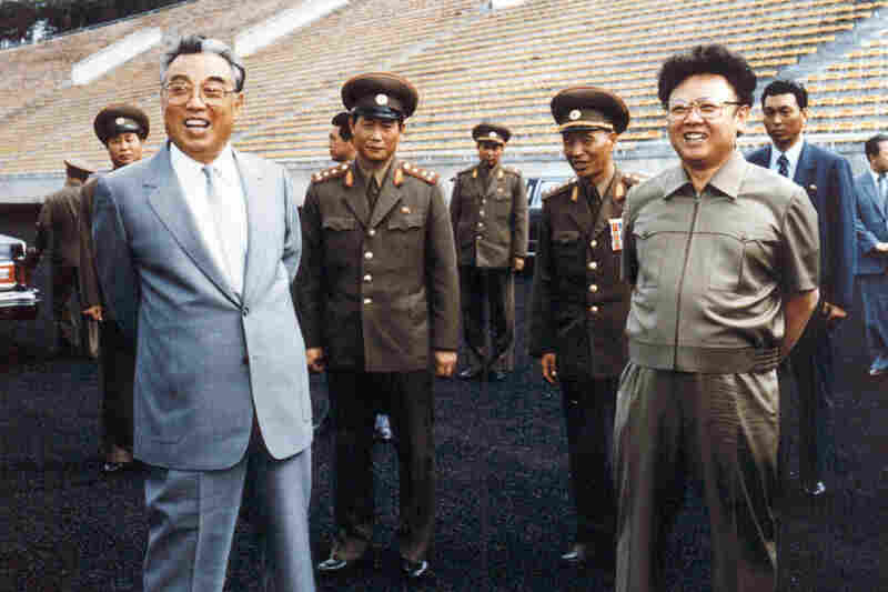 1992: Kim Jong Il (right) and his father and then-leader Kim Il Sung (left) inspect a soccer ground in Pyongyang. Kim Jong Il was named general secretary of the ruling Workers' Party, one of two top posts left vacant since the death of the elder Kim in 1994.