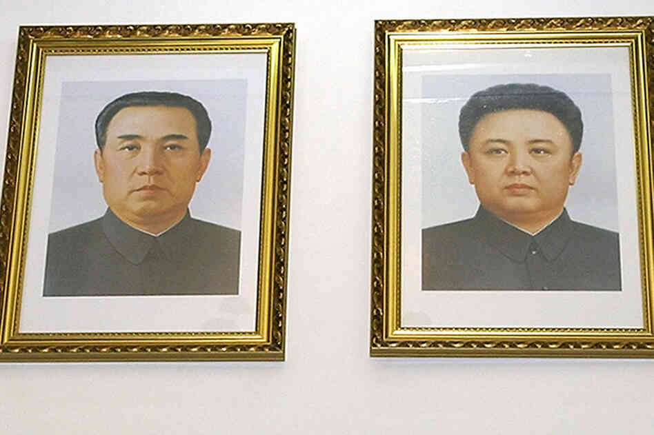 Feb. 28, 2004: Portraits of Kim Il Sung (left) and Kim Jong Il hang on the wall at the North Korean embassy in Beijing.