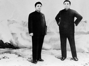 An undated official picture shows former North Korean leader Kim Il Sung (right) with his son and eventual successor Kim Jong Il.