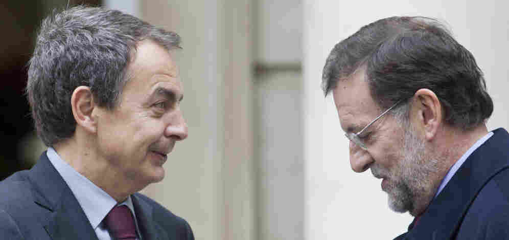 Spain's outgoing Prime Minister Jose Luis Rodriguez Zapatero (left) talks with Spain's incoming Prime Minister Mariano Rajoy before a meeting at the Moncloa Palace in Madrid on Friday.